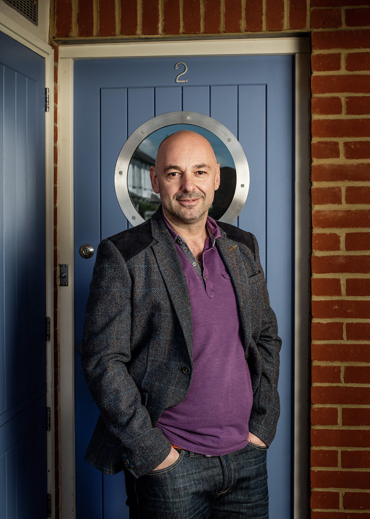 Dr Mel Mehmet MBE photographed at home